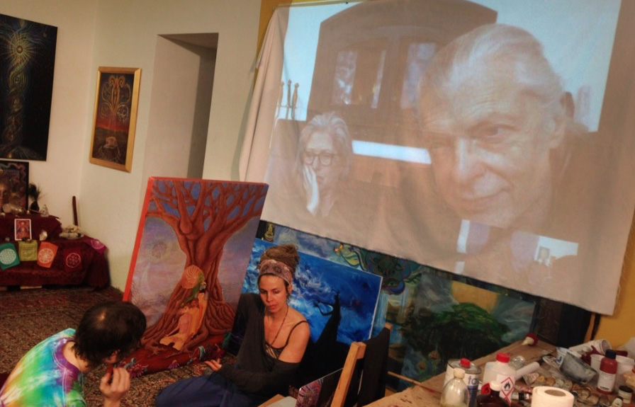 Students showing their work to Alex and Allyson grey via video-call